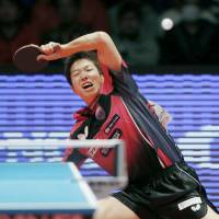 Jun Mizutani competes at the table tennis national championships in Tokyo on Sunday. | KYODO