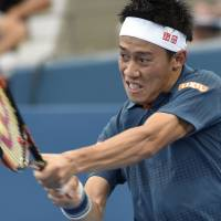 Kei Nishikori hits a return against Mikhail Kukushkin during the Brisbane International on Wednesday in Brisbane, Australia. | AFP-JIJI