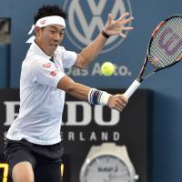 Tomic ousts Nishikori in quarters