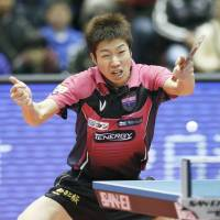 Jun Mizutani competes during the national table tennis championships on Saturday at Tokyo Metropolitan Gymnasium. | KYODO