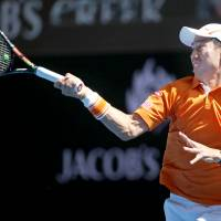 Kei Nishikori makes a forehand return during his first-round match against Philipp Kohlschreiber at the Australian Open on Monday in Melbourne, Australia. | AP