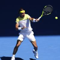 Rafael Nadal plays a shot from Spanish compatriot Fernando Verdasco in their first-round match at the Australian Open on Tuesday. Verdasco won 7-6 (8-6), 4-6, 3-6, 7-6 (7-4), 6-2. | AP