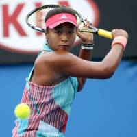 Japan's Naomi Osaka plays a shot from Ukraine's Elina Svitolina in their second-round match at the Australian Open on Thursday. Osaka won 6-4, 6-4. | AP