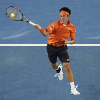 Kei Nishikori plays a shot from Spain's Guillermo Garcia-Lopez in their third-round match at the Australian Open on Friday. | REUTERS