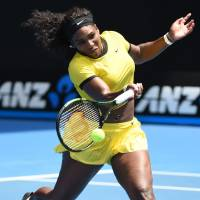 Serena Williams plays a shot against Maria Sharapova in their quarterfinal match at the Australian Open on Tuesday. Williams won 6-4, 6-1. | AFP-JIJI