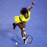 Serena Williams reaches to play a shot during her Australian Open semifinal win over Agnieszka Radwanska in Melbourne on Thursday. | AP