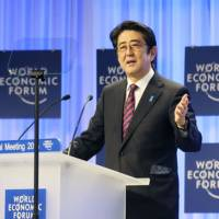 Prime Minister Shinzo Abe makes a speech on Jan. 22, 2014, at the opening plenary session of the WEF 2014 annual meeting in Davos. | CABINET PUBLIC RELATIONS OFFICE