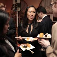 Guests mingle while enjoying Japanese food. | JAPAN NIGHT ORGANIZATION COMMITTEE