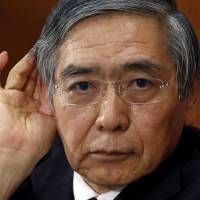 Bank of Japan Gov. Haruhiko Kuroda attends a news conference at BOJ headquarters in Tokyo in January. | REUTERS
