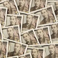 Global uncertainty has sent investors scurrying for safety, bolstering the yen to the dismay of Japan's exporters. | BRIGITTE JANDA