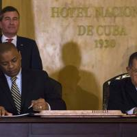 United States Transportation Secretary Anthony Foxx (left) and Cuban Minister of Transportation Adel Yzquierdo Rodriguez sign a bilateral airline transportation agreement as Assistant Secretary of State for Economic and Business Affairs Charles Rivkin looks on in Havana Tuesday.   AP