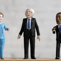 A Bernie Sanders action figure prototype is displayed with Hillary Clinton and Barack Obama figures in a photo illustration taken in the Brooklyn borough of New York Thursday. A Brooklyn product design company, FCTRY, created a prototype for the 6-inch (15-cm) tall plastic version of the U.S. senator from Vermont and started a Kickstarter campaign with a goal of raising $15,000 to fund production. | REUTERS