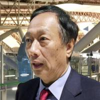 Terry Gou, chairman of Taiwan's Hon Hai Precision Industry Co., speaks to reporters at Kansai International Airport in Osaka on Saturday. | KYODO