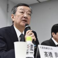 Sharp Chief Executive Officer Kozo Takahashi speaks during a news conference on Thursday in Tokyo. He said neither of its potential partners is preferred over the other at this point. | KYODO