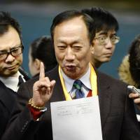 Hon Hai Precision Industry Co. Chairman Terry Gou addresses reporters after a surprise meeting in Osaka on Friday. | KYODO