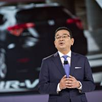 Takahiro Hachigo, president and chief executive officer of Honda Motor Co., speaks at the Detroit auto show in January. | BLOOMBERG