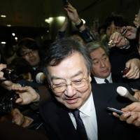 Kozo Takahashi, president of Sharp Corp., leaves the company's offices in Tokyo on Thursday. | BLOOMBERG