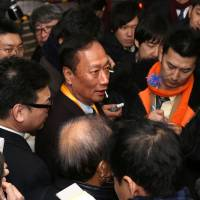 Foxconn Technology Group Chairman Terry Gou speaks at the Sharp Corp. headquarters in Osaka on Friday. | BLOOMBERG