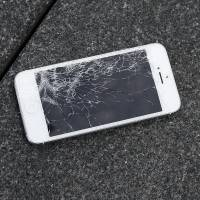 An Apple iPhone with a cracked screen is seen after a drop test from the DropBot, a robot used to measure the sustainability of a phone to dropping, at the offices of SquareTrade in San Francisco in August. Apple for the first time is accepting banged up iPhones as a trade-in from those wanting to upgrade. | AP