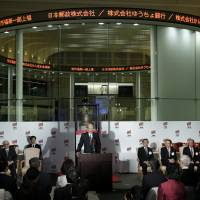 Taizo Nishimuro, president of Japan Post Holdings Co., makes remarks at the company's listing on Nov. 4. It was the nation's largest privatization in decades. | BLOOMBERG