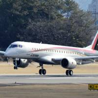 The Mitsubishi Regional Jet, the first domestically developed small passenger jet by Mitsubishi Aircraft Corp., lands at Nagoya Airport in Aichi Prefecture after a test flight Wednesday. | KYODO