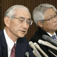 Nippon Steel & Sumitomo Metal Corp. President Kosei Shindo (left) speaks during a news conference Monday in Tokyo about acquiring Nisshin Steel Co., as Nisshin Steel President Toshinori Miki looks on. | KYODO