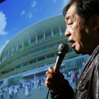 Architect Kengo Kuma speaks during a news conference after his design for the new National Stadium was announced in Tokyo on Dec. 22. | AP