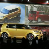 The 2008 Scion xB is unveiled in 2007 along with the xD (background right0 during the Chicago Auto Show. Toyota announced Wednesday that it is discontinuing its Scion brand, aimed at younger car buyers, after years of slumping sales. Scion owners can still visit Toyota service departments for maintenance and repairs. | AP