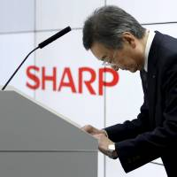 Sharp Corp. Chief Executive Kozo Takahashi bows at a news conference in Tokyo on Thursday. | REUTERS