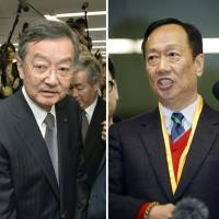 Sharp President Kozo Takahashi (left) and Hon Hai Chairman Terry Gou are hoping to close the takeover deal soon. | KYODO