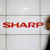 Sharp's decision to sell to a Taiwanese firm made clear it was turning its back on a common move by Japanese firms to merge in a bid to fend off overseas competition. | REUTERS
