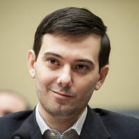 Martin Shkreli, former chief executive officer of Turing Pharmaceuticals LLC, smiles during a House Committee on Oversight and Government Reform hearing on prescription drug prices in Washington, D.C., Thursday. Shkreli, who is no longer with Turing and faces federal fraud charges unrelated to the drugmaker, declined to make any comments to the committee. 'On the advice of counsel, I invoke my Fifth Amendment,' he said. | BLOOMBERG
