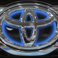 The corporate logo of Toyota Motor Corp. is seen in 2011 on a vehicle on display at the company's showroom in Tokyo. A global recall of nearly 2.9 million Toyota SUVs was prompted by a Canadian investigation into a crash that killed two people. U.S. safety regulators revealed the probe in documents posted Thursday. A week earlier, Toyota announced the huge recall because the rear seat belts can be cut in a severe crash. If that happens, the belts won't restrain passengers. | AP