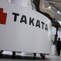 A Takata Corp. logo is displayed in an auto showroom in Tokyo in November. | REUTERS