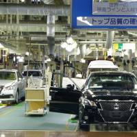 Toyota Motor Corp.'s luxury Crown sedan is assembled at one of its plants in the city of Toyota, Aichi Prefecture. The carmaker said Monday it will suspend all domestic production of its vehicles from Feb. 8 through Feb. 13 after an explosion at a steel plant caused parts shortages. | KYODO