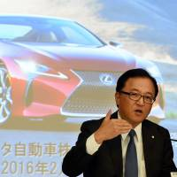 Toyota Managing Officer Tetsuya Otake speaks at a news conference about the automaker's third-quarter results at its Tokyo headquarters on Friday. | AFP-JIJI