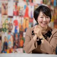 Hiromi Sogo, the editor-in-chief of Vingt-Cinq Ans and Richesse, is interviewed in Tokyo on Feb. 23. Sogo will take part in a Finance Ministry panel on how to rein in Japan's ballooning national debt. | BLOOMBERG
