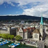 Early stroll: The Limmat River in Zurich, A beautiful place for a morning walk before your big date. Enjoy a panoramic view of the city from the observation tower on Uetliberg Mountain. | BLOOMBERG