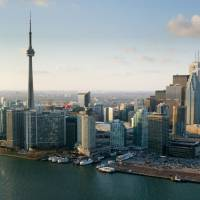 Towering heights: The iconic CN Tower stands among other buildings in Toronto's skyline. While the city's Koreatown has some great karaoke bars, finding a smaller cocktail bar to chat may be a better option on your date. | BLOOMBERG
