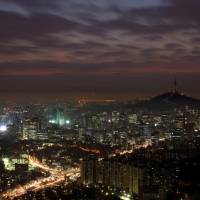 Evening cityscape: A view of buildings around the N Seoul tower, a landmark in a rapidly growing city. While you're up there, be sure to bring a padlock to add to the 'Locks of Love.' | BLOOMBERG