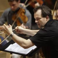 Bostonian rhapsody: Boston Symphony Orchestra music director Andris Nelsons leads rehearsals at Symphony Hall in Boston. | AP
