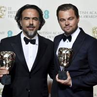 Good night: Alejandro G. Inarritu and Leonardo DiCaprio pose with their BAFTA awards at a ceremony in London on Feb. 14. | REUTERS