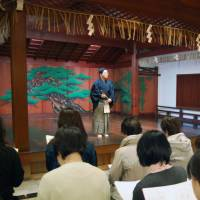 Noh news is good news: Men and women attend a noh session at a theater in Osaka. | KYODO