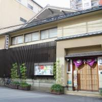 Behind the door: Yamamoto Noh Gakudo in Osaka was built more than 90 years ago. | KYODO