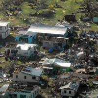 A remote Fijian village is photographed from the air during a surveillance flight conducted by the New Zealand Defence Force on Sunday after Cyclone Winston lashed the island nation. | REUTERS