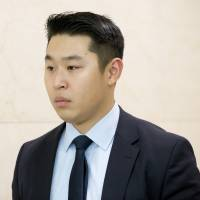 Police officer Peter Liang leaves the courtroom at the end of the day on Tuesday at Brooklyn Supreme Court in New York in his trial on charges in the shooting death of Akai Gurley. | AP