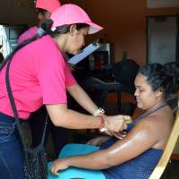 A health worker sprays mosquito repellent on a pregnant woman's arm during a campaign to fight the spread of Zika virus in the municipality of Soledad near Barranquilla, Colombia, on Feb. 1. | REUTERS