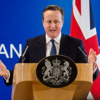 British Prime Minister David Cameron speaks during a news conference at an EU summit in Brussels on Friday. | AP