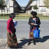 Abortion protesters stand outside of the Whole Woman's Health abortion clinic in San Antonio, Texas, on Feb. 16. | BLOOMBERG