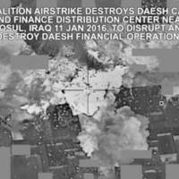 This image made from Jan. 11 video released by the U.S. military shows an airstrike targeting an Islamic State group cash and finance distribution center near Mosul, Iraq. The extremist group that once bragged about minting its own currency is having a hard time meeting expenses as a result of coalition airstrikes, plummeting oil prices and a cutoff of payments from the Iraqi government, the sum of which has eroded millions from its finances since last fall. | COMBINED JOINT TASK FORCE-OPERATION INHERENT RESOLVE VIA AP